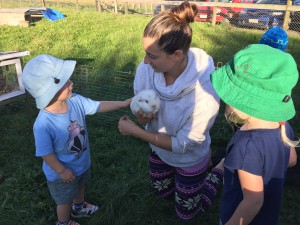 Ethan patting his friend Pinky at the farm.